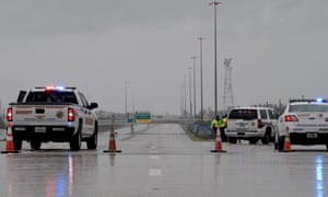 State troopers cordon off a stretch of highway to Houston.
