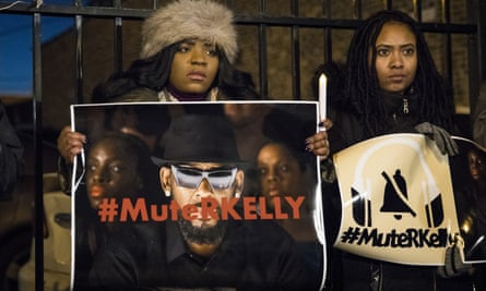 #MuteRKelly supporters protest outside R. Kelly's studio in Chicago.