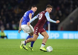Aston Villa's Jack Grealish shields the ball from Leicester City's Jonny Evans.