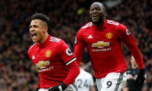 Romelu Lukaku (right), who scored Manchester United's first goal, celebrates with Alexis Sánchez (left)  after he hit United's second