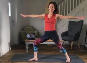 Jane doing yoga at home