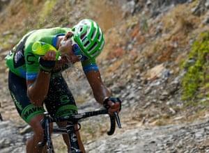 Cannondale-Garmin rider Kristijan Koren has a drink as he climbs
