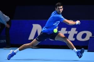 Novak Djokovic eyes the ball as he readies a backhand return.