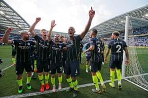 City's players including Aguero, De Bruyne, Bernardo Silva and Kompany celebrate victory.