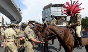 A police personnel wearing a Covid-19 coronavirus-themed helmet sits on his horse as he takes part in an awareness campaign at a traffic junction in Hyderabad, India.