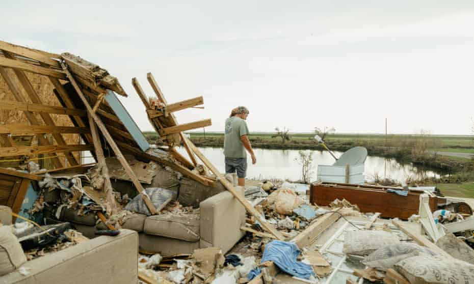 Kip de'Laune looks for salvageable items at his home in Pointe-aux-Chenes. Photograph: Bryan Tarnowski/The Guardian