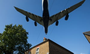 FILES-BRITAIN-POLITICS-ENVIRONMENT-AVIATION-POLLUTION-HEATHROW(FILES) In this file photo taken on October 17, 2016 A passenger aircraft passes over a residential house as it prepares to land at London Heathrow Airport in west London. - London Mayor Sadiq Khan, along with environmental charities and local councils, on May 1, 2019, lost a court battle to prevent an expansion of Heathrow, Britain's busiest airport. Opponents to the introduction of a third runway at the west London airport cite the negative impacts on noise and air pollution, habitat destruction, transport congestion, and climate change. (Photo by Daniel LEAL-OLIVAS / AFP)DANIEL LEAL-OLIVAS/AFP/Getty Images