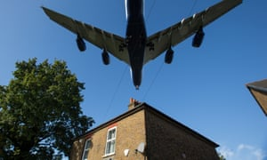 A passenger plane passes over a residential house near Heathrow Airport in west London.
