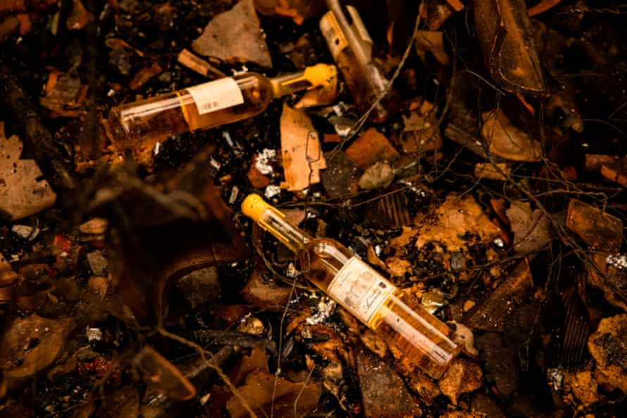 Charred bottles of wine from the Castello di Amorosa winery sit in the debris of the Glass fire, which gutted part of the property.