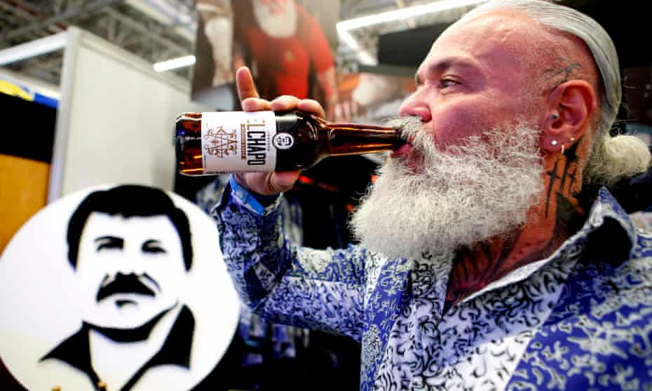 A model wears clothing and drinks beer from the El Chapo 701 line, which bears the name of the drug lord.