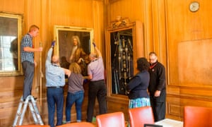 Edward Colston's portrait being removed from the office of Bristol's lord mayor, Cleo Lake, who is also a member of the Countering Colston campaign group.