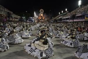 Performers from the União da Ilha samba school parade in the Sambadrome