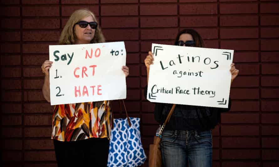 Rally Against Critical Race Theory in Los Alamitos, California<br>epa09192750 Protesters hold posters reading 'Say no to 1: CRT (Critical Race Theory) 2: Hate' and 'Latinos Against Critical Race Theory' during a demonstration in front of the Los Alamitos Unified School District building against the teaching of Critical Race Theory in Los Alamitos, California, USA, 11 May 2021. Critical Race Theory is a concept that seeks to understand and address inequality and racism in the US, recognizing that systemic racism is part of American society and challenges the beliefs that allow it to flourish. EPA/ETIENNE LAURENT