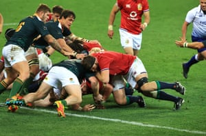 Wyn Jones goes over for the first Lions try.