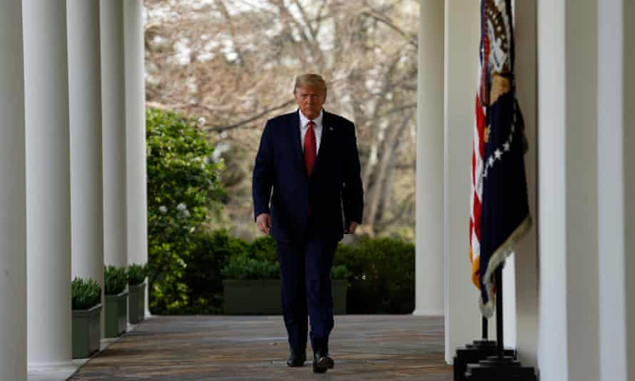 Donald Trump walks along the Colonnade at the White House on 29 March 2020.