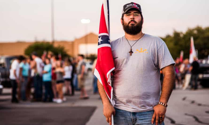 Mathew Heimbach, poses for portrait at a confederate flag rally that ended in a parking lot in Knoxville, Tennessee. Theresa May has excluded more foreign nationals for unacceptable behaviour than any other home secretary, a spokesman said.