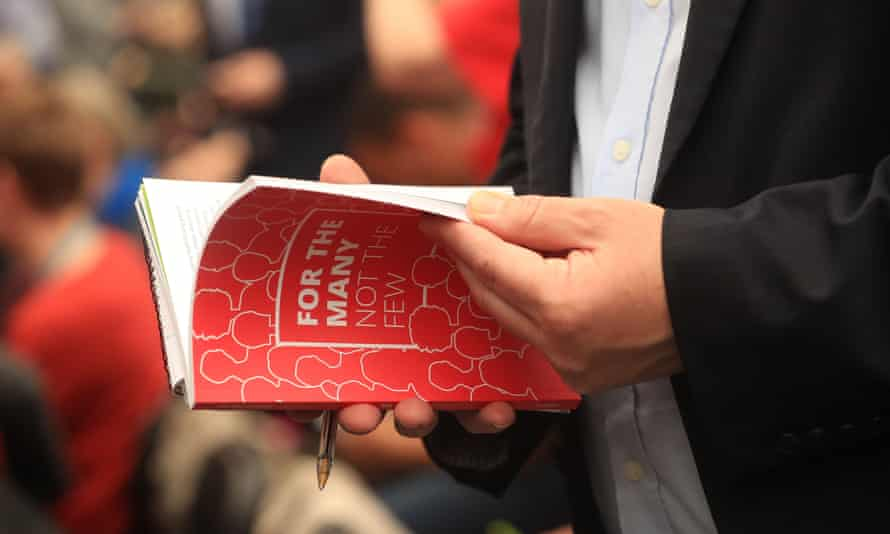 A journalist reads the Labour party's general election manifesto.