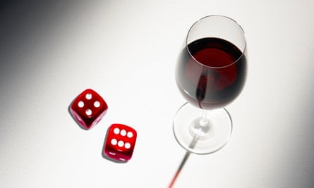 Glass of red wine and two dice