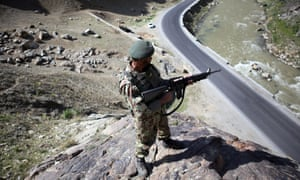 An Afghan soldier guards a roadside in Kabul