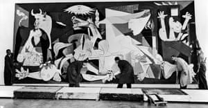 Guernica by Pablo Picasso being hung in the Municipal Museum in Amsterdam, 1956.