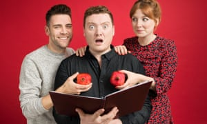 James Cooper and Alice Levine hold red peppers in front of Jamie Morton's chest. He looks faux shocked and is holding open the book My Dad Wrote a Porno
