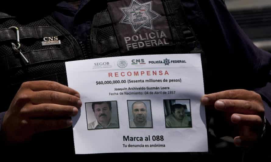 Police shows a reward notice for information leading to the capture of drug lord Joaquin 'El Chapo' Guzman on Thursday.
