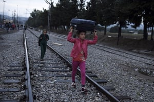 Idomeni, Greece Syrian children walk on the railway tracks to cross the border from the northern Greek village to southern Macedonia