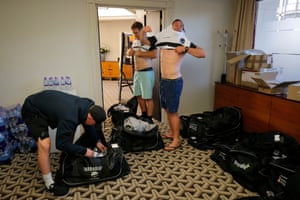 New Zealand players Mitchell Drummond (left), George Bridge (right) and Luke Whitelock try on shirts for size in the kit room at the Hilton on Park Lane.