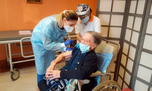 A 108-year-old care home resident in Milan is given her Covid jab.