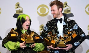 Billie Eilish and her brother Finneas O'Connell pose with Grammy awards on Sunday.