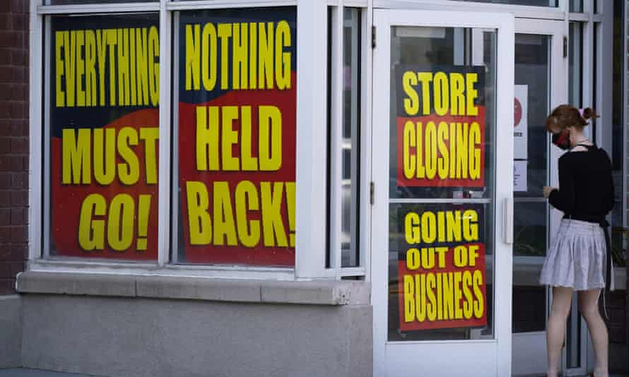Store with closing down/going out of business signs.