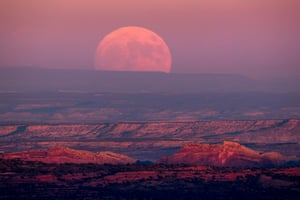 A nearly full moon rises above the Valley of the Gods near Mexican Hat, Utah