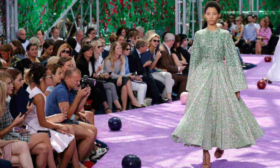 A model presents a creation by Belgian designer Raf Simons as part of his haute couture autumn and winter 2015-16 collection for Christian Dior.