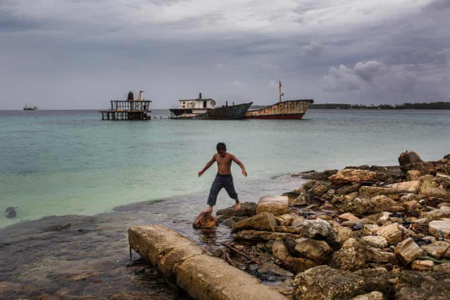 A child plays near abandoned ships in the Marshall Islands' capital, Majuro. Unemployment in the country is around 36%.