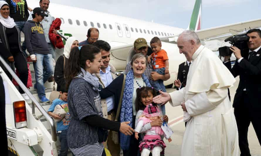 Pope Francis welcomes the refugees after landing at Ciampino airport in Rome
