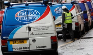 A worker walks past a Pimlico Plumbers van in London, Britain February 10, 2017.