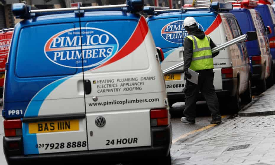 A worker walks past a Pimlico Plumbers van in London, Britain February 10, 2017.