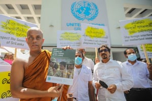 A Buddhist monk holds the cover of a document detailing war crimes allegedly committed by the Liberation Tigers of Tamil Eelam (LTTE), during a protest in front of the UN office in Colombo, Sri Lanka. Members of the International People's Organisation of Sri Lanka were protesting at UN sanctions on the island nation for 'war crimes and human rights violations'. The Sri Lanka government has firmly denied such violations and has urged member countries to defeat a 'politically biased' resolution.