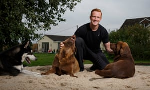 Greg Rutherford in the long jump pit in his garden, which he opened up to Woburn children for the sports day.