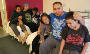 Emily Saitu and her family inside their motel room in South Auckland.