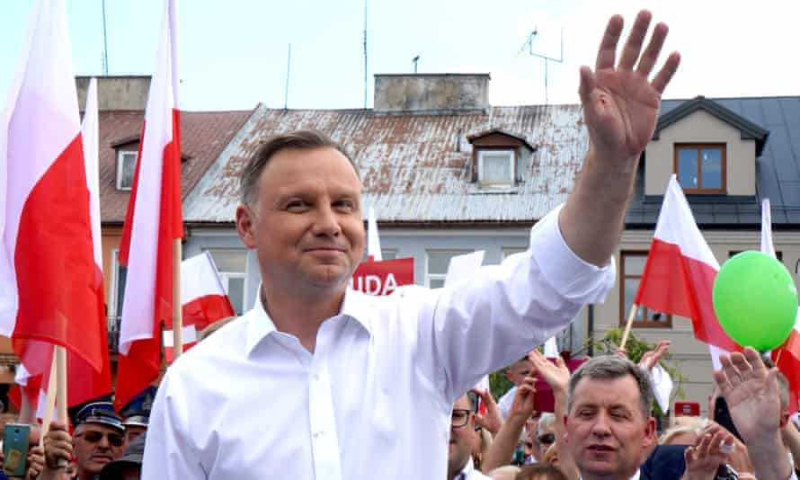 Andrzej Duda greets supporters during a campaign meeting ahead of the presidential election in Plonsk, central Poland, on 16 June 2020.