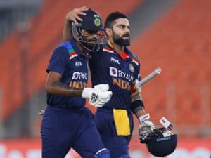 India's Hardik Pandya and Virat Kohli (right) walk off after their innings.