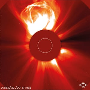 SOHO satellite image of the Sun and a coronal mass ejection