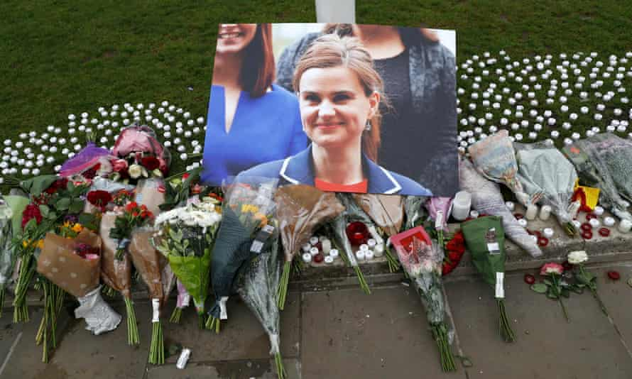 Tributes and candles left for Jo Cox are seen in Parliament Square, London.