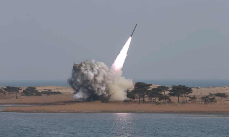 North Korea launches a projectile in this undated photograph made available on Friday by the North Korean news agency KCNA.