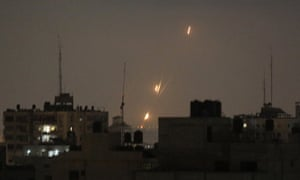 Flames of rockets fired at Israel by Palestinian militants from the Gaza Strip.