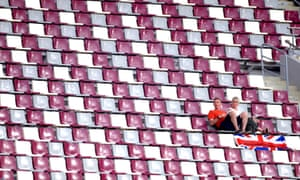 Supporters in the stands at The Khalifa International Stadium.