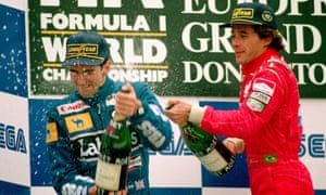 Ayrton Senna celebrates with Damon Hill