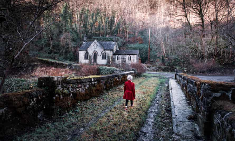A little girl walking towards an old scary, spooky abandoned house, church in the woods, located in the Derbyshire Peak District National Park, hallow<br>2A6G93K A little girl walking towards an old scary, spooky abandoned house, church in the woods, located in the Derbyshire Peak District National Park, hallow