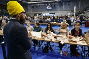 Election workers count votes at the Emirates Arena in Glasgow.